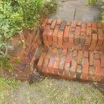 vernieuwen en restaureren tuinmuur erfscheiding